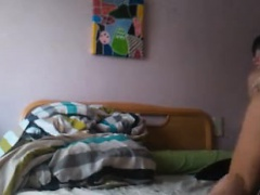 Teen strips and bates on bed -...
