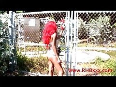 RedHead Barbie Cuffed to a Fence...