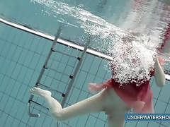 Katya Okuneva in red dress pool...